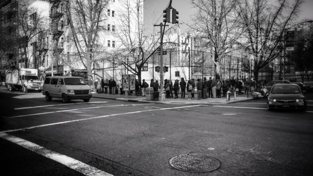 A long line of prospective Cronut buyers approaches Dominique Ansel's Bakery.