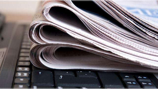 газеты на клавиатуре